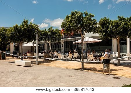 Torrevieja, Valenciana, Spain - May 11 2020 : Spanish Bar Terrace With Tables Set At 2 Metres Apart