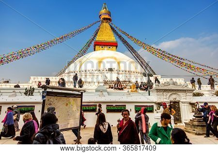 Kathmandu, Nepal-december 4,2018: Sacred Boudhanath Buddhist Stupa With Prayer Flags And Pilgrimage