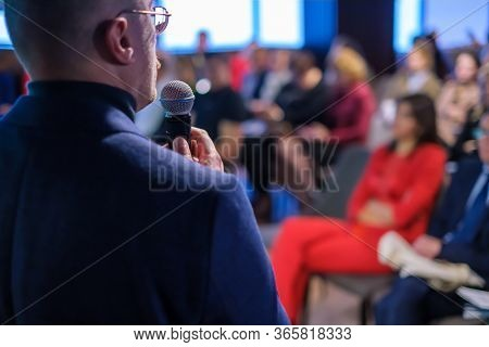 Male presenter speaks to audiences at seminar