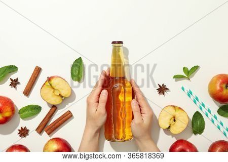 Female Hands Hold Bottle Of Cider On White Background. Composition With Cider