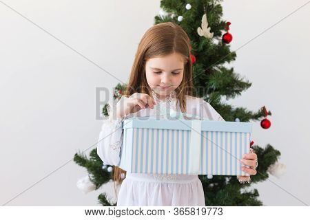 Holidays, Presents, Christmas, X-mas Concept - Happy Child Girl Opens Gift Box.
