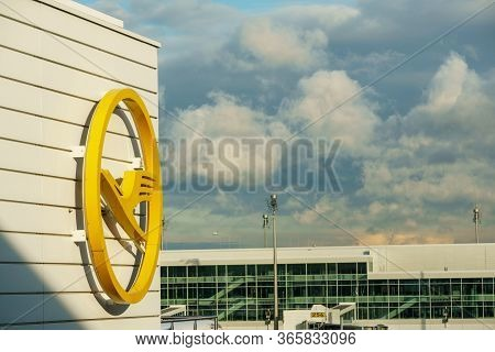 Germany, Munich - Circa 2020: Lufthansa Logo With Cloudy Sky On The Background. Airlines And Travel
