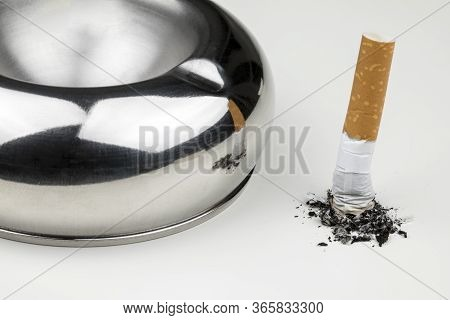 Stubbed Cigarette Butt Stub With Ash On White Background