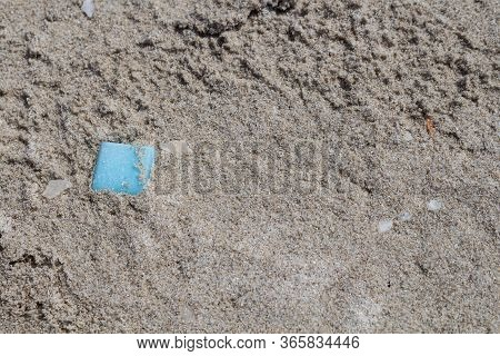 Ecology - Beach Discoveries: Blue Tile, Forgotten Or Thrown Out On The Sandy Beach Of Mediterranean