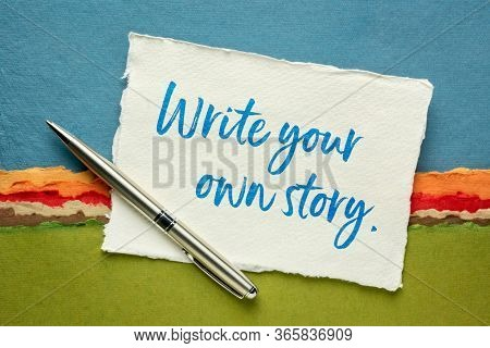 write your own story inspirational note - handwriting on a handmade rag paper against abstract landscape, creativity and personal development concept