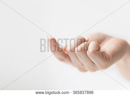 Contact Lens On The Index Finger. Using Contact Lenses To Correct Vision.