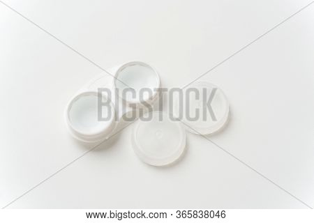 Contact Lenses Are In Solution In Contact Lens Container On A Light Background. Contact Lenses For C