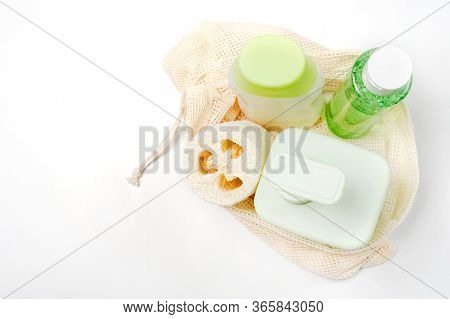 Different Containers For Shampoo, Conditioner, Tonic, Liquid Soap In Eco Bag. Loofah Or Luffa Washcl