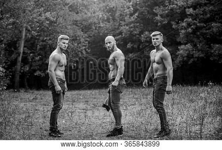 Little Break. Bodybuilders In Jeans. Three Sexy Guys. Brutal Guys Pose With Naked Torso. Handsome Gu