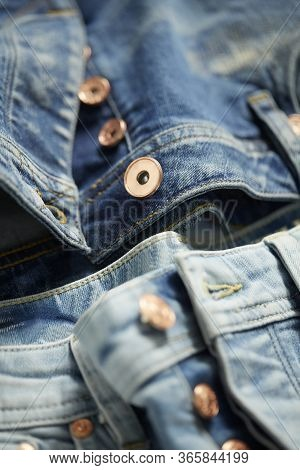 Details Of Nice Blue Jeans. Fashionable Clothes. Close Up Light Blue Denim Jeans, And Jeans Buttons.