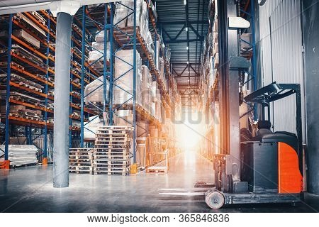 Large Logistics Hangar Warehouse With Lots Shelves Or Racks, Pallets Of Goods. Shipping And Cargo De