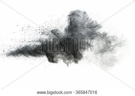 Black Powder Explosion.the Particles Of Charcoal Splash On White Background.