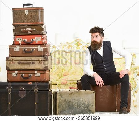 Luggage And Relocation Concept. Man With Beard And Mustache Packed Luggage, White Interior Backgroun