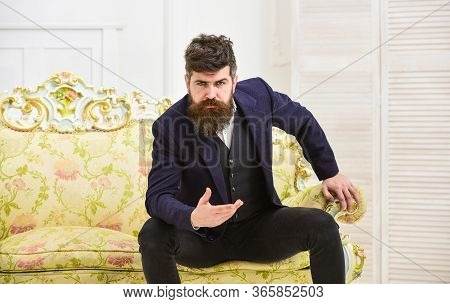 Fashion And Style Concept. Macho Attractive And Elegant On Serious, Thoughtful Face Sitting On Old F