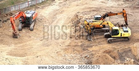 Excavator Working To Get Rid Of The Rubbish In A Demolition Site. Demolition Of The Old Industrial B