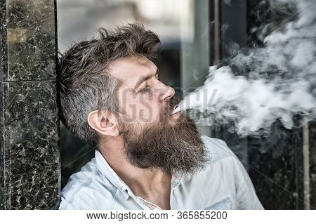 Man With Beard And Mustache Smoking, Black Marble Background. Smoking And Habits Concept. Hipster Wi