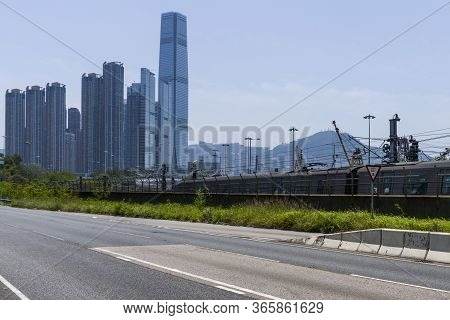 Hong Kong - April 29 2020 : Mtr Train Traveling To The Kowloon Station, With Icc Tower And West Kowl