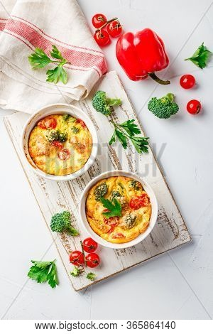 Frittata With Broccoli In Two Ceramic Forms. Frittata With Broccoli, Sweet Bell Peppers And Tomatoes