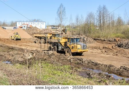 Kirishi, Russia - 8 May, Three Axle Dump Trucks At Work, 8 May, 2020. Start Of Construction Of A Mot