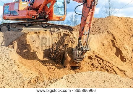 Kirishi, Russia - 8 May, Set Of Sand In The Bucket, 8 May, 2020. Start Of Construction Of A Motor Br