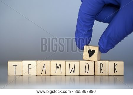 Wooden Cubes With The Words Team Work For Business Concept Or Health Care Nurses Or Doctor Covid-19,