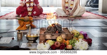 Hindu Bride And Groom Sit Opposite Fire During Indian Yajna Ritual. Authentic Vedic Fire Ceremony Ca