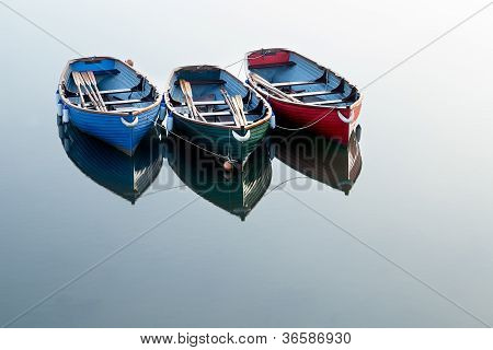 Red, Green And Blue Rowing Boats