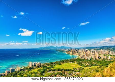 Honolulu Hawaii landscape view from Diamond Head hike trail mountain lookout of Waikiki beach and city background. Copy space on blue sky