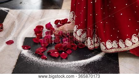 Bride In A Red Sari. Beautiful Traditional Indian Wedding Ceremony. The Bride Takes A Step Into The