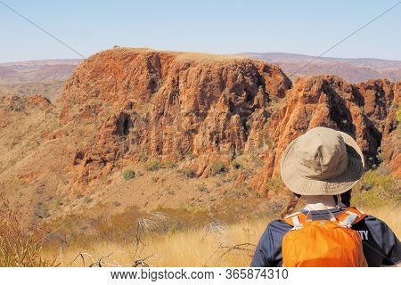 Backpacker Looking Out Over Cliffs At Trephina Gorge, Northern Territory, Australia 2017