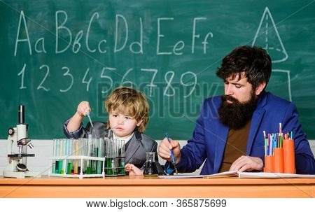 Biotechnology Research Concept. Wisdom. Back To School. Son And Father At School. Formula. Experimen
