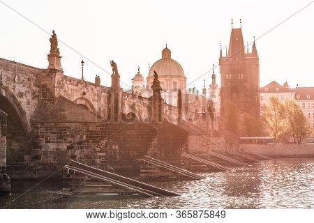 Morning On Charles Bridge, Czech: Karluv Most. Hazy Sunrise Daybreak. Praha, Czech Republic