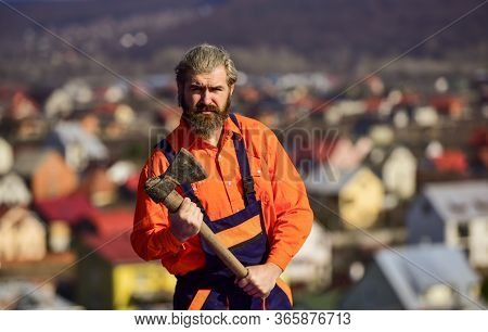 Man In Uniform Hold Ax. Brutal Bearded Man Axe In Hands. Brutal And Bearded. Builder With Axe. Hands