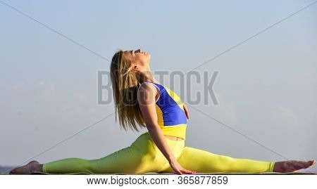 Stretching Muscles. Woman Practicing Split. Flexible Girl Outdoor. Attractive Woman Practicing Yoga.