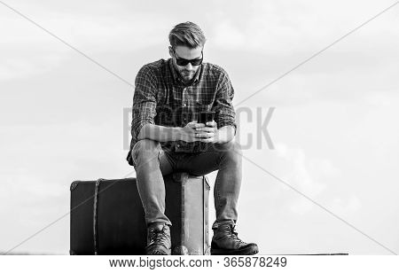 Business Trip. Handsome Guy Traveler. Guy Outdoors With Vintage Suitcase. Luggage Concept. Calling T