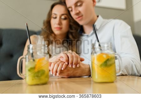 Young Happy Man Makes An Offer Of Hands And Hearts To His Girlfriend In Cafe. Special Occasion Day A