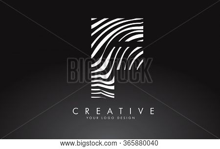 F Letter Logo Design With Fingerprint, Black And White Wood Or Zebra Texture On A Black Background.