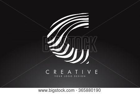 C Letter Logo Design With Fingerprint, Black And White Wood Or Zebra Texture On A Black Background.