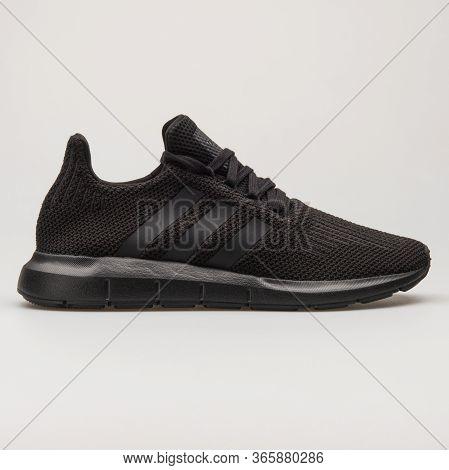 Vienna, Austria - August 13, 2018: Adidas Swift Run Black Sneaker On White Background.