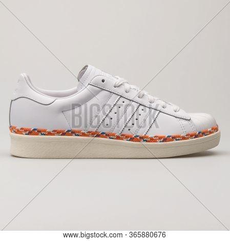 Vienna, Austria - August 13, 2018: Adidas Superstar White And Orange Sneaker On White Background.