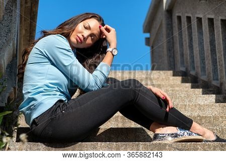 Beautiful Face Dreamy Brunetty Girl Sitting On The Stairs