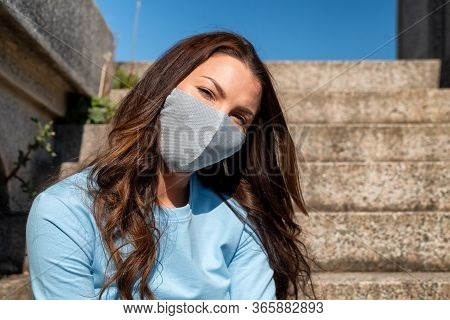 Girl Wearing Luxury Silver Fashion Face Mask Due Coronavirus Covid-19 Protection.