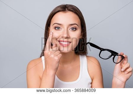 Portrait Of Positive Cheerful Girl Follow Doctors Recommendation Hold Transparent Contact Lens Want