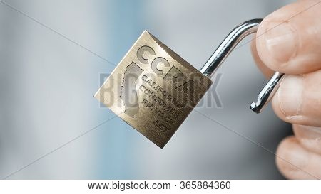 Ccpa Concept: Businessman In Blue Shirt And Tie Show An Open Lock With The Text Ccpa California Cons