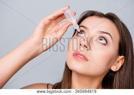 Close Up Photo Of Charming Girl Want Cure Her Myopia Refresh Eye Use Eye Dropper Isolated Over Gray