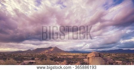 View overlooking valley with beautiful cloudscape at sunset.