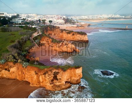 Aerial Drone Point Of View Image Of Praia Do Pinhao Landscape, Atlantic Ocean And Limestone Rocky He
