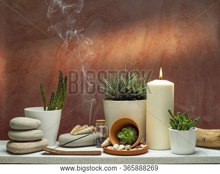 Room Decoration With Scented Incense Stick, Candle, Rocks And Cactus On White Shelf Against Old Bric