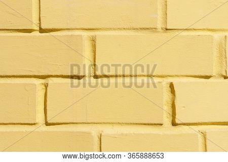 Yellow Brick Wall Close Up Texture. Stonewall Backdrop.