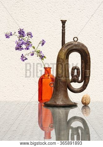 Still Life With Flower In Vintage Glass Bottle, Whole Walnut And Old Rusty Bugle Against A High Key